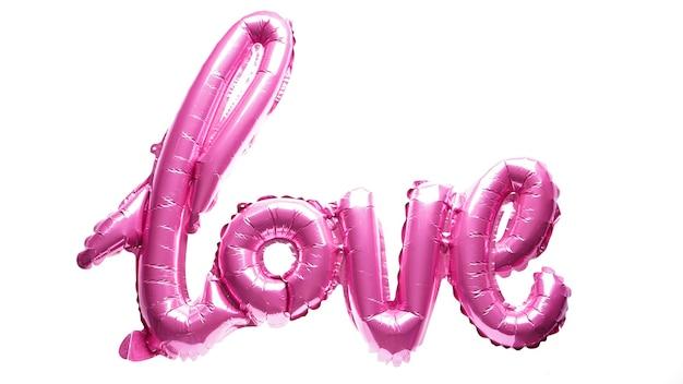 """Walentynki. różowe balony w kształcie słowa """"miłość"""", na białym tle. koncepcja miłości."""