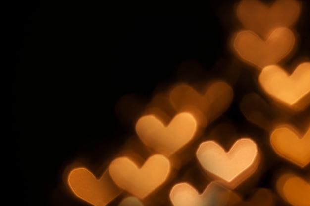 Walentynki tło z bokeh świateł w kształcie serca