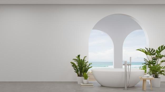 Wanna na betonowej podłodze dużej łazienki.
