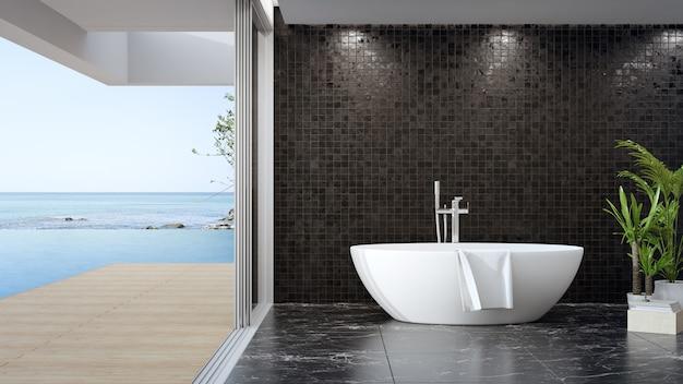 Wanna na czarnej marmurowej podłodze dużej łazienki w nowoczesnym domu
