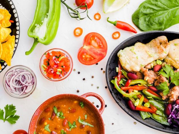 Warzywa i kubek z dodatkami