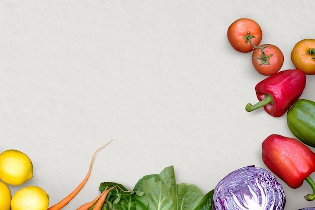 Warzywa obramują szare tło dla kampanii zdrowia i dobrego samopoczucia