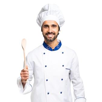 Wesoły szef kuchni na białym tle