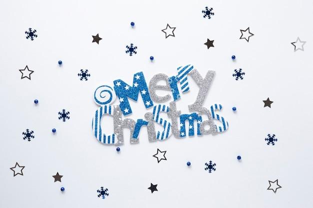 Wesołych świąt bożego narodzenia znak z gwiazdami