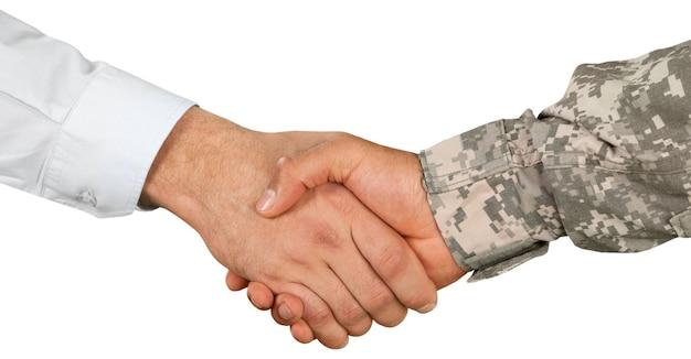 Weteran uścisk dłoni wojskowy biznesmen żołnierz armii żołnierz zbliżenie