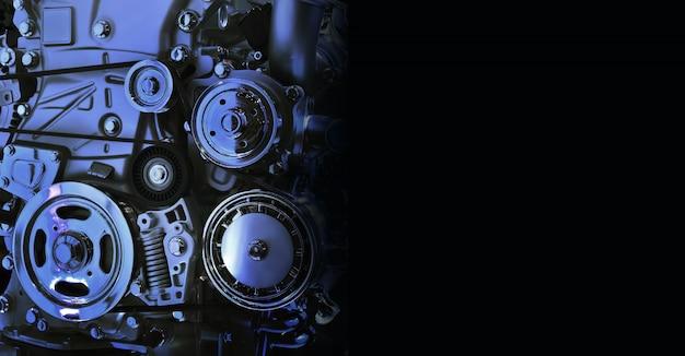 Wewnętrzna konstrukcja silnika samochodu w kolorze niebieskim na czarnym tle wolnej przestrzeni po prawej stronie na tekst.