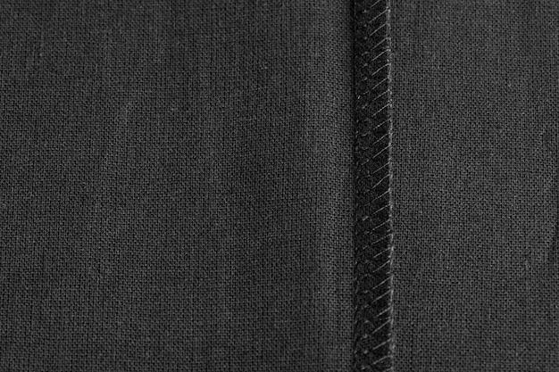 Wewnętrzny szew na czarnej lnianej tkaninie, jako tło