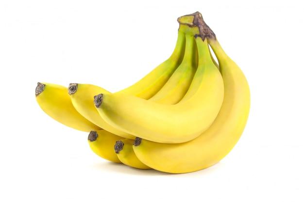 Wiązka banany odizolowywający na biel powierzchni