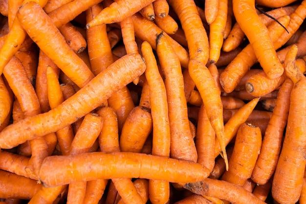 Wiązka marchewki, fotografia dla tła lub warzywo wzoru. dieta roślinna, wegetariańska, wegańska