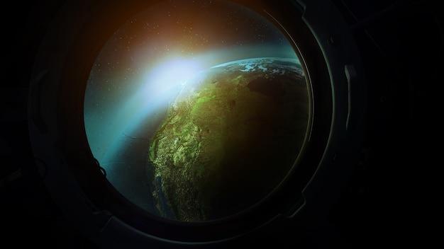 Widok planety ziemi z iluminatora z orbity