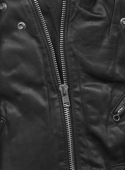 Widok z bliska czarna skórzana kurtka. tekstura tło