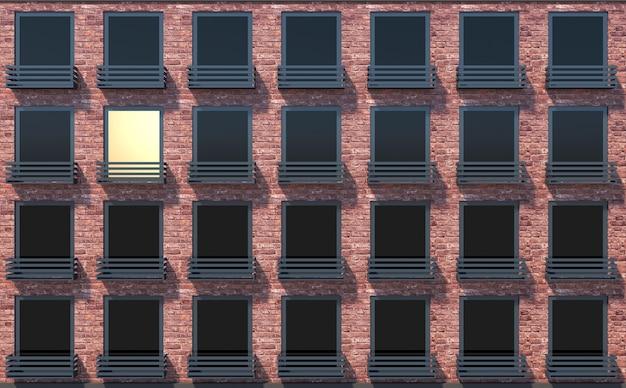Widok z bliska na nowoczesny budynek z cegły i okno ze światłem