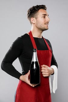 Widok z boku buźki męski kelner