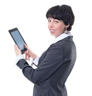 Widok z boku. kobieta sukcesu w biznesie z cyfrowym tabletem. na białym tle