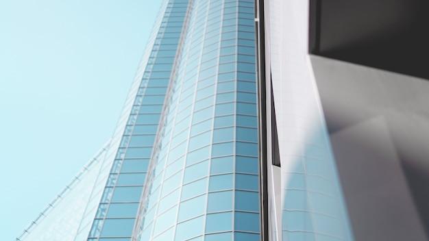 Widok z dołu nowoczesnych drapaczy chmur w dzielnicy biznesowej na tle błękitnego nieba - zbliżenie tła