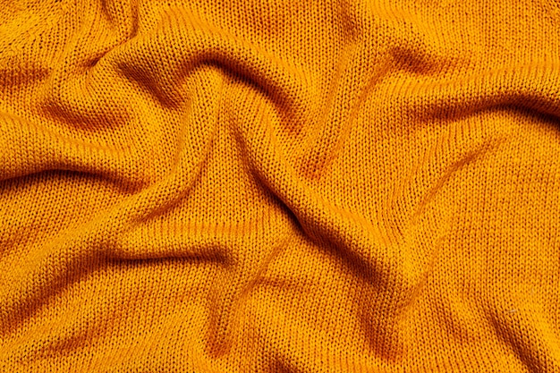 Widok z góry dzianiny pomarańczowej wełny