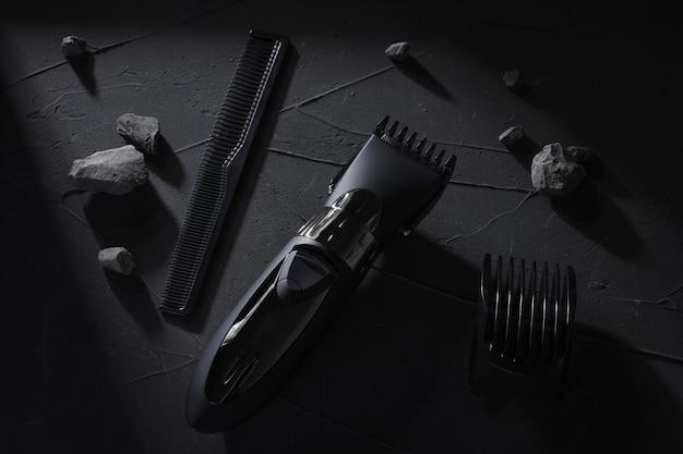 Widok z góry. maszynka do włosów i głowy na ciemnym betonowym stole z twardymi cieniami