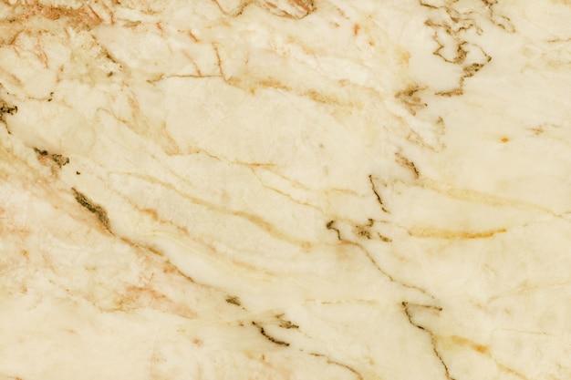 Widok z góry na naturalną marmurową teksturę, kamienną podłogę z bezszwowym brokatem na zewnątrz i designerski blat ceramiczny.