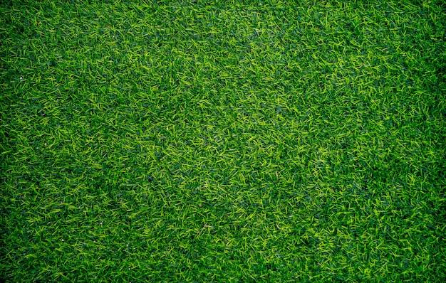 Widok z góry na tle zielonej trawy sztucznej. koncepcja tapety i tła.