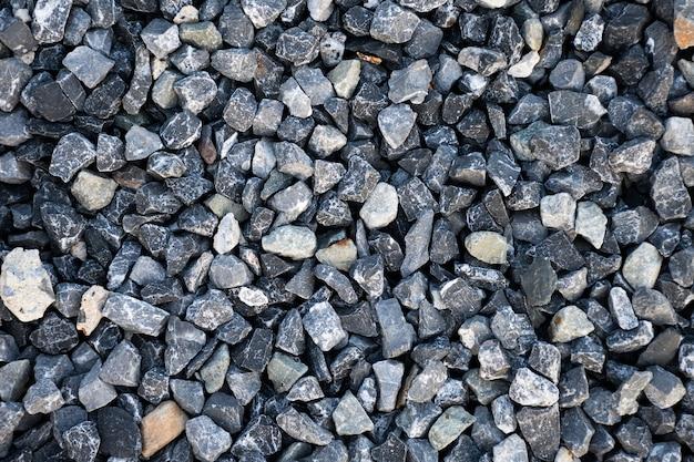Widok z góry niebieskiego żwiru budowlanego tekstura tło. małe granitowe kamienne tło pełnej klatki.