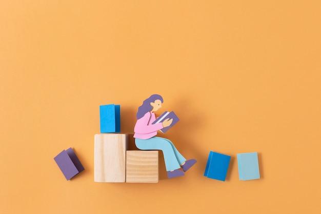 Widok z góry papierowa kobieta na drewnianym kawałku