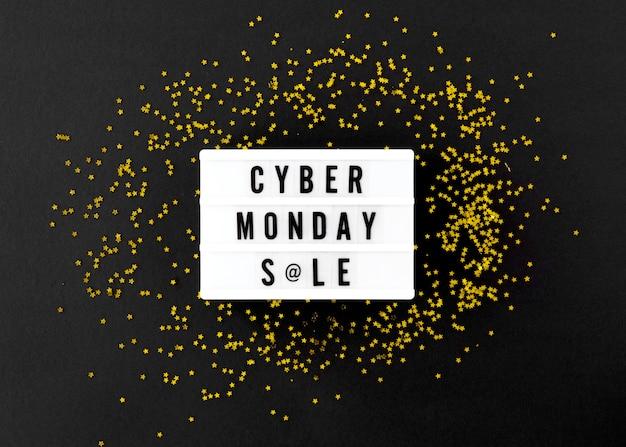 Widok z góry podświetlanej skrzynki na cyber poniedziałek ze złotym brokatem