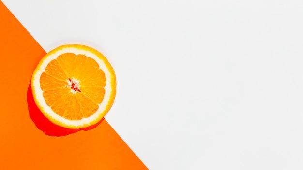Widok z góry pomarańczowy plasterek ramki