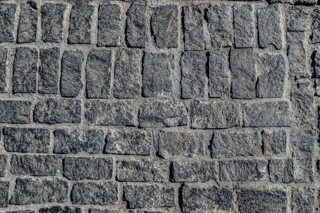 Widok z góry stary tekstura kostki brukowej chodnik coddlestone
