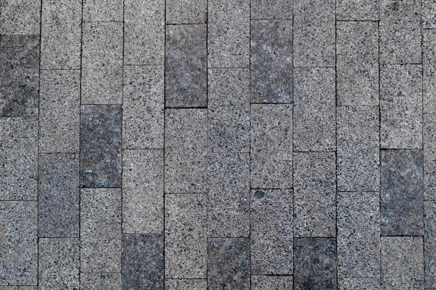 Widok z góry tekstury chodnika z kamienia brukowanego
