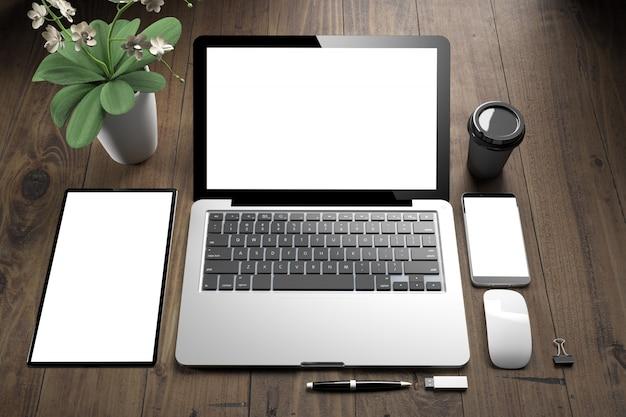 Widok z góry urządzeń z białym ekranem na drewnianym stole
