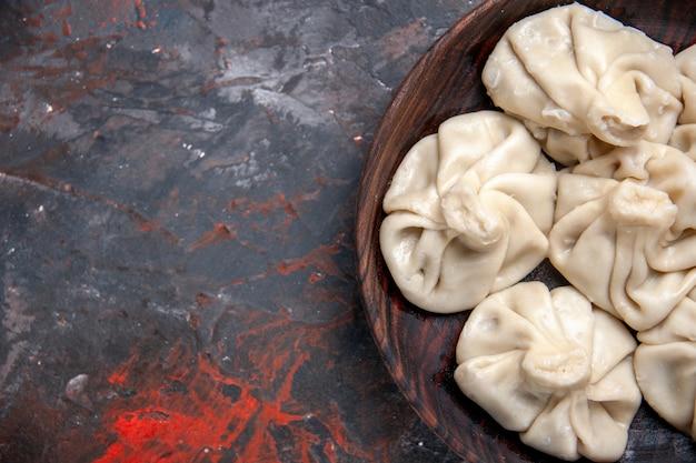 Widok z góry zbliżenie khinkali brązowy miskę apetycznego chinkali