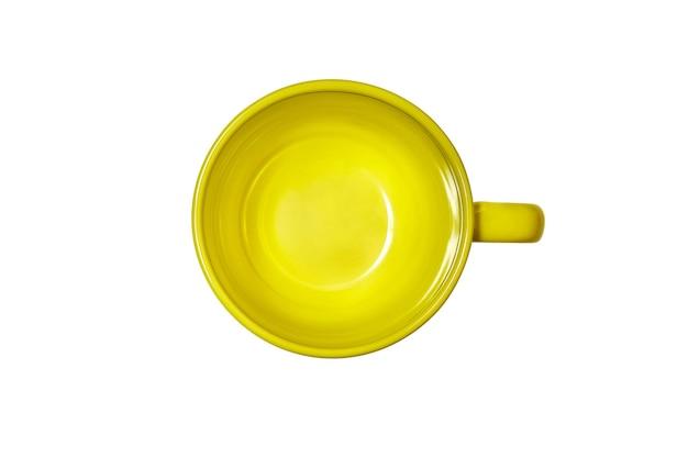 Widok z góry zielony żółty pusty czysty okrągły z uchwytem ceramiczny kubek do kawy na izolowanym białym tle