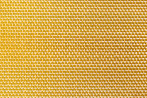 Widok z góry żółty plaster miodu. bezszwowa tekstura plastra miodu.