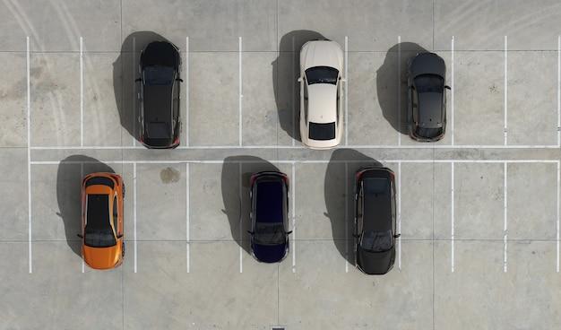 Widok z lotu ptaka na puste parkingi i zaparkowane samochody