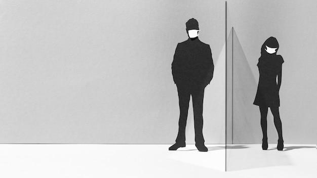 Widok z przodu mężczyzny i kobiety ze szklaną przegrodą i maskami medycznymi