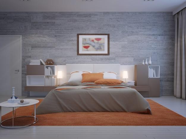 Widok z przodu na przytulną sypialnię z murowaną tapetą i pomarańczową dekoracją