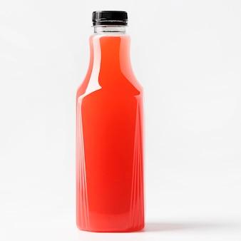 Widok z przodu szklanej butelki czerwonego soku