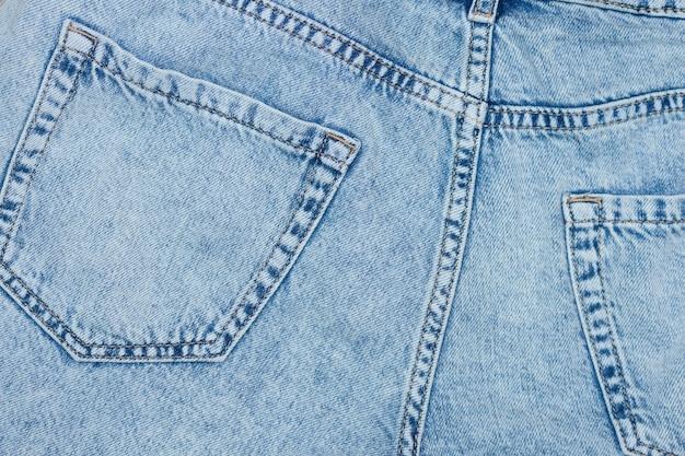 Widok z tyłu kieszenie niebieskich dżinsów z bliska nowoczesne tło