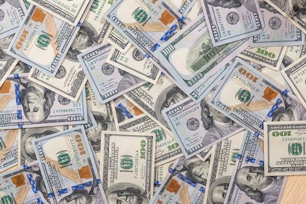 Wiele banknotów 100 dolarów jako tło