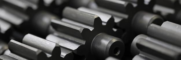 Wiele metalowych kół zębatych fabryki przemysłu streszczenie