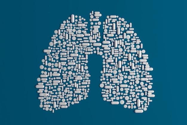 Wiele tabletek porozrzucanych na niebiesko w kształcie płuca