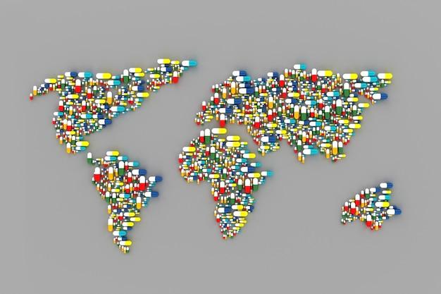 Wiele tabletek rozrzuconych na stole w formie mapy świata