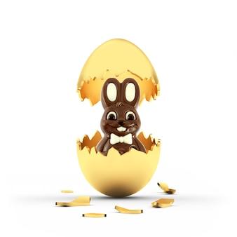 Wielkanocny królik czekoladowy w złamanej złotej skorupce jajka