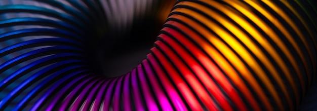 Wielobarwna spirala slinky zabawki, obraz panoramiczny