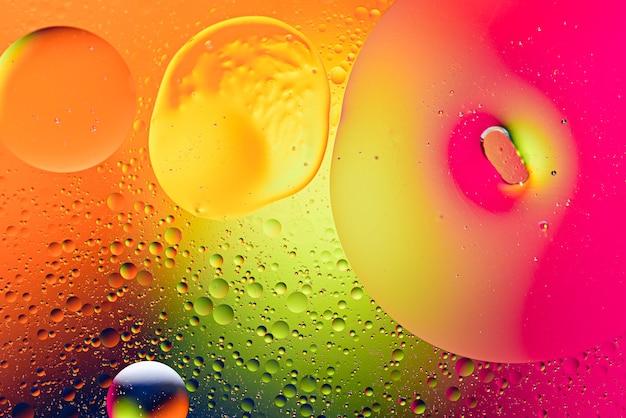 Wielobarwne plamy, bąbelki na neonowym tle sztuki, modna abstrakcyjna tekstura