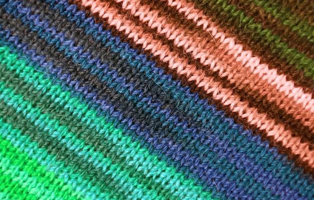 Wielokolorowe paski alpaca dzianiny tkaniny wełnianej tekstury na tle