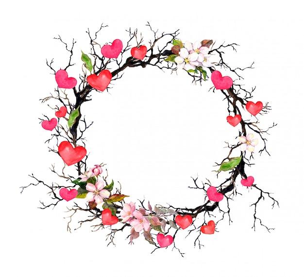 Wieniec kwiatowy - gałązki z wiosennymi kwiatami, serca. akwarela koło granicy na walentynki, wesele