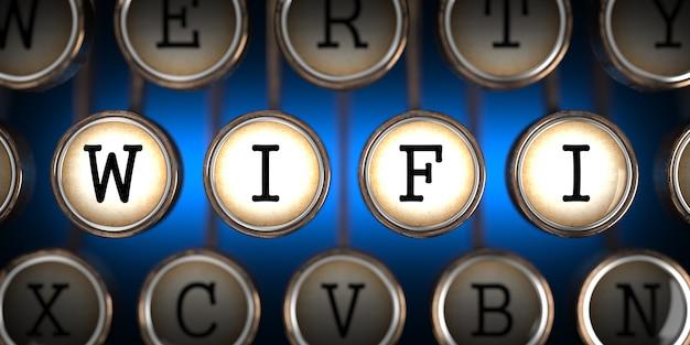 Wifi na klawiszach starej maszyny do pisania na niebieskim tle.
