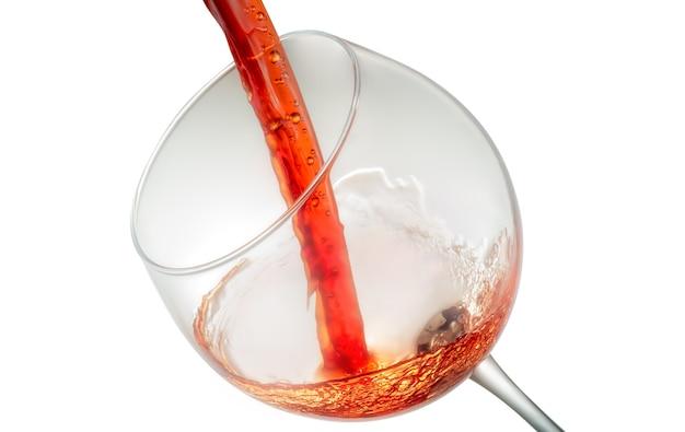Wina rozpryskiwania na szkle na białym tle