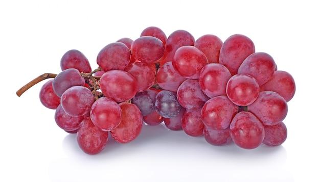 Winogrona odizolowywający dalej nad białym tłem